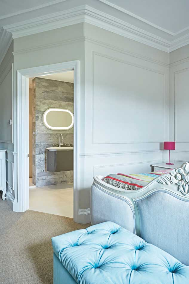 With the right design, an en suite installed in a stolen corner can flow seamlessly into the bedroom. White is a classic choice for rooms without natural light. Bathroom by Sapphire Spaces