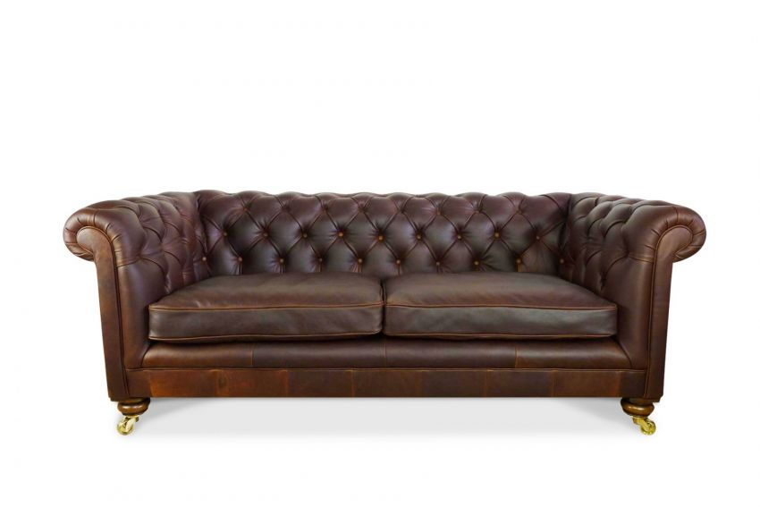 A gorgeous buttoned back and armed Chesterfield, 3 seater with feather filled seat cushions.  Finished off in the highest quality leather and round mahogany feet with brass castors.  Even this model can be adjusted to suit each ion our customers.